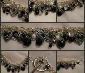 Jet Black Crystal, Gun Metal Grey and Silver Charm Bracelet